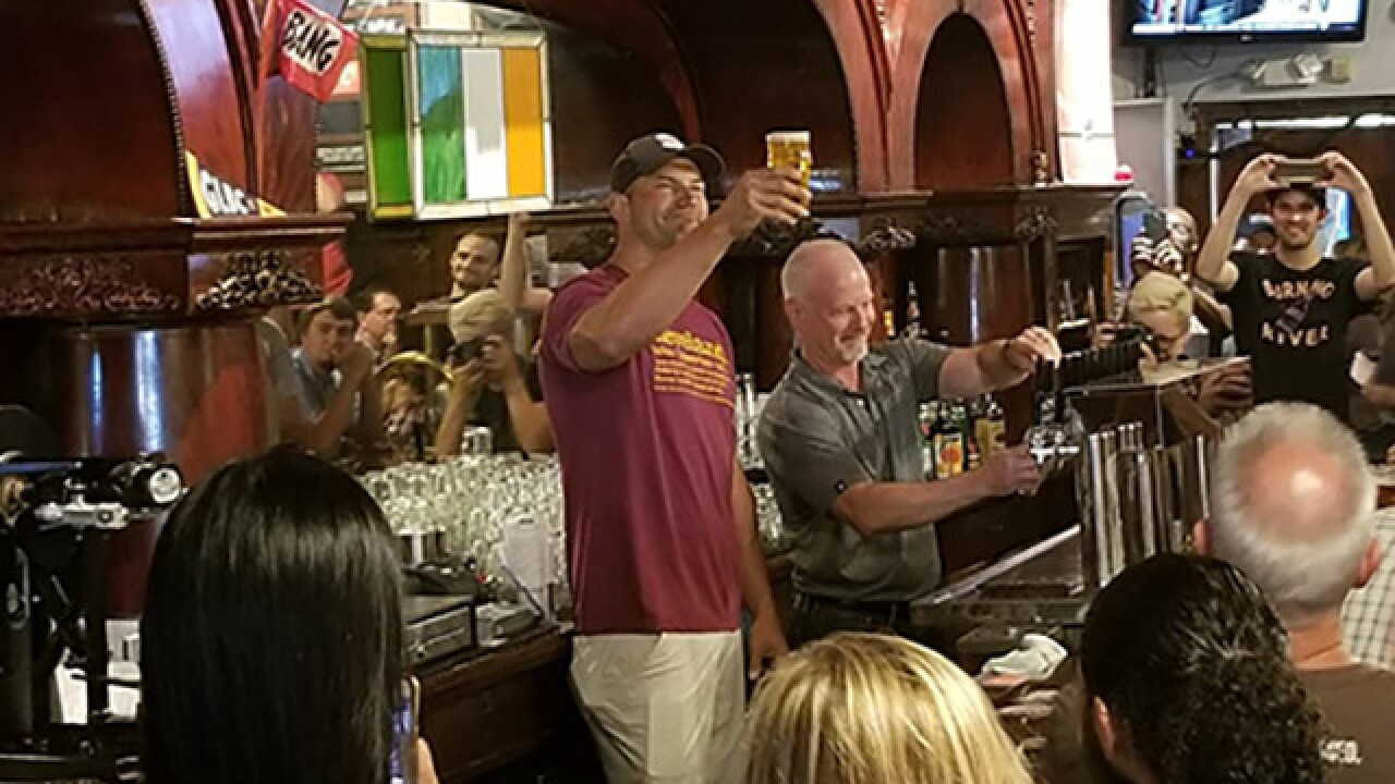 Fans meet Joe Thomas as he pours his new beer, now on tap at Great Lakes Brewing Co.