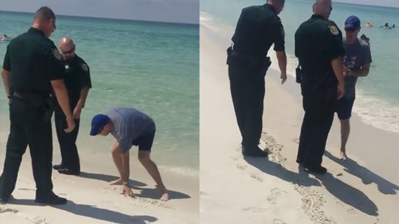 Man told to leave portion of beach following law