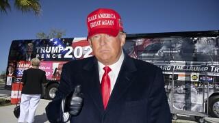 President Donald Trump wearing Make America Great Again hat superimposed over Trump 2024 bus