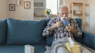 Senior Man With a Cold Drinking Tea