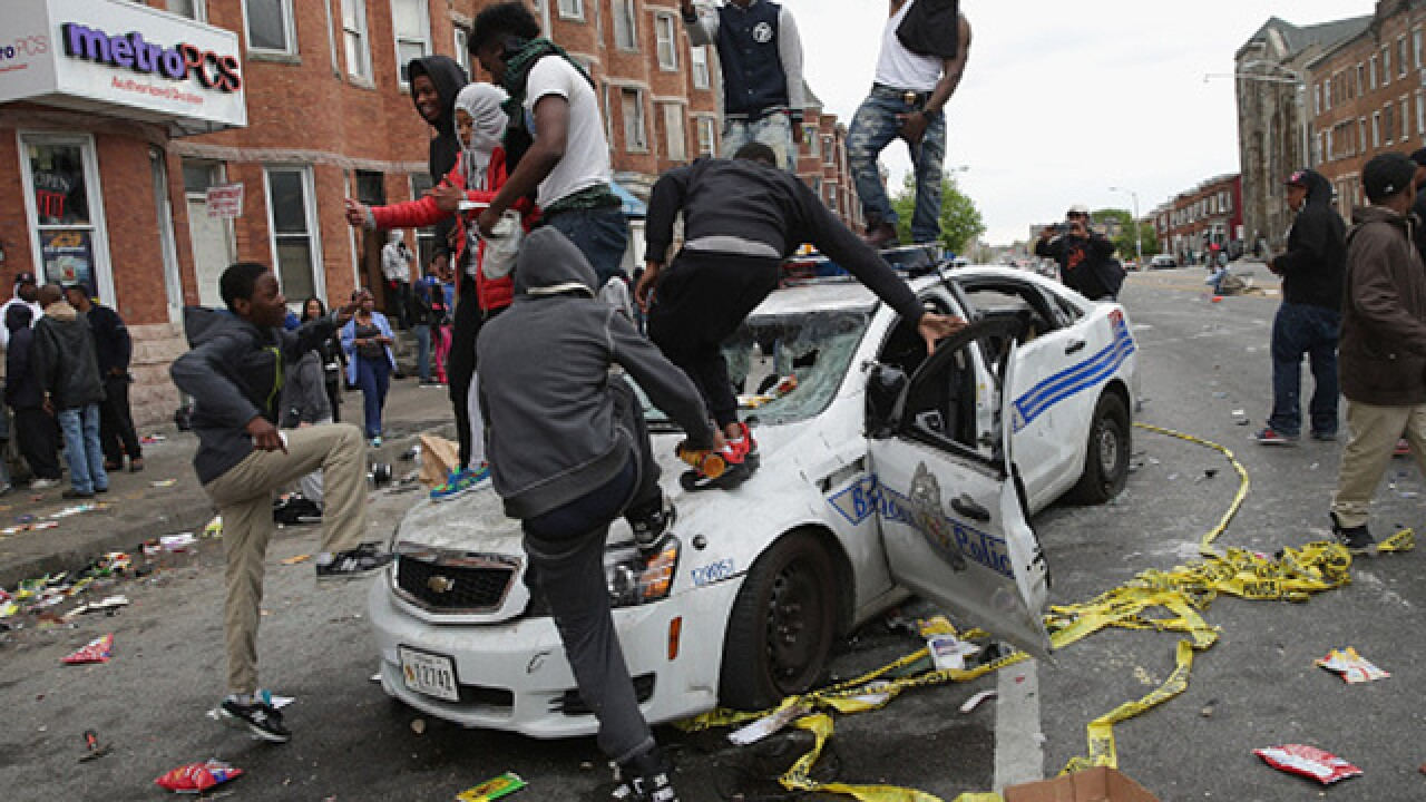Protesters and police clash in Baltimore
