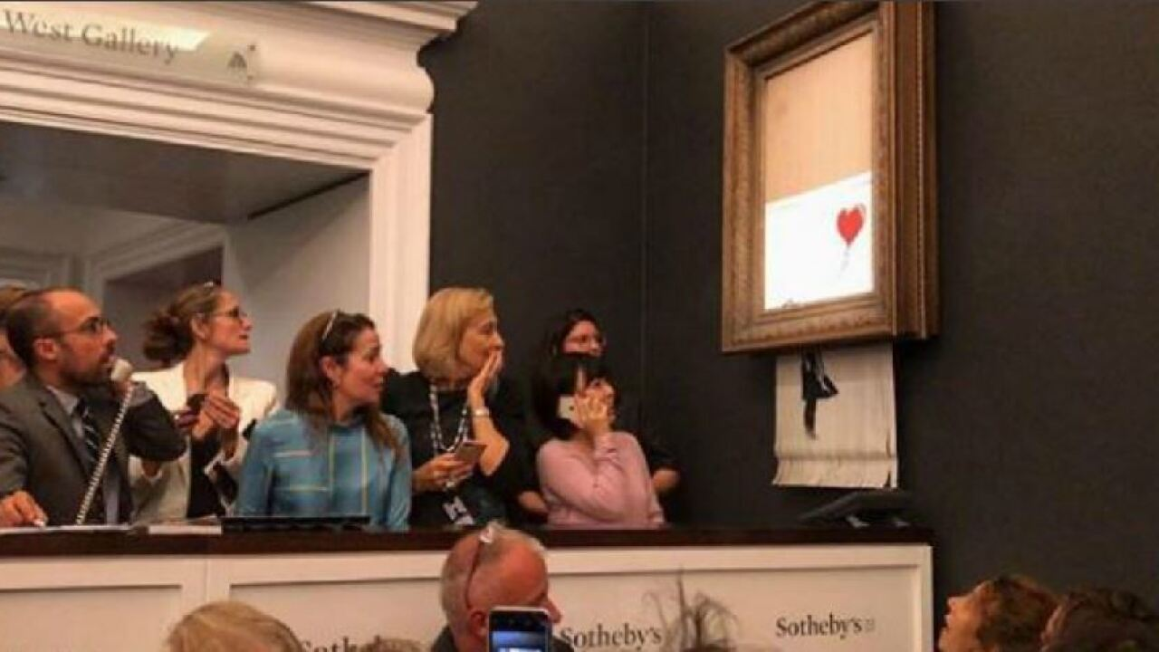 SHOCK: $1.4 million Banksy painting 'self-destructs' moments after being sold