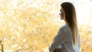 Woman looking out window_tmj4 article_May - 640x360.jpg