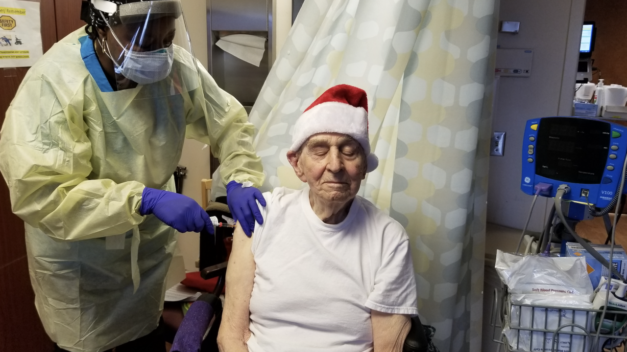 Murray Simon becomes the first Veteran at the Loch Raven VA Medical Center's Community Living Center to receive the COVID-19 vaccine