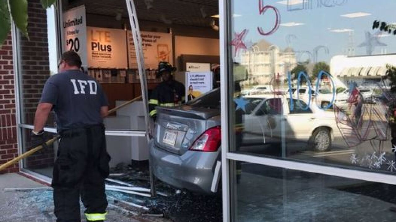 2 employees injured when car crashes into Sprint
