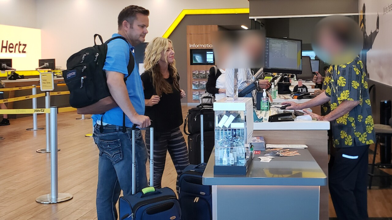 Lori and Chad Daybell at a car rental counter in Maui on Sunday, Feb. 16.   Courtesy Ursula Berliner