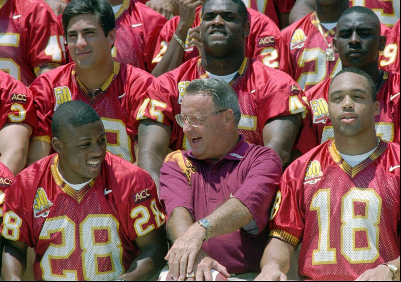 Florida State Seminoles head coach Bobby Bowden shares laugh with running back Warrick Dunn, Aug. 18, 1996