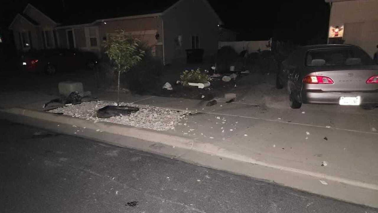 Photos showing property and vehicle damage after a driver went off road in Stansbury Park Friday night.