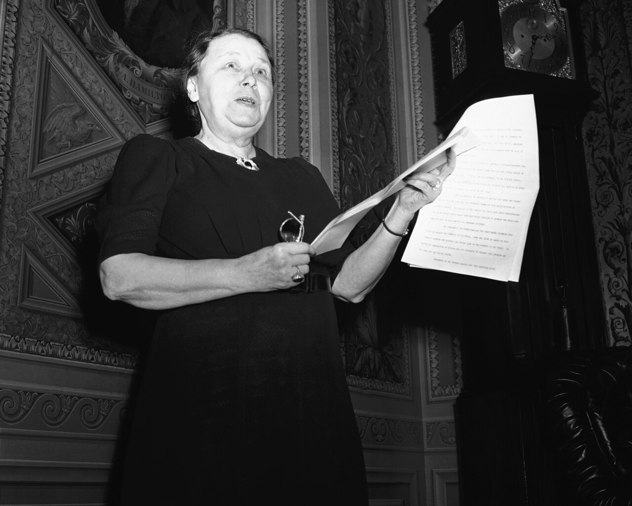 """Preparing to take the floor for one of her rare speeches, Hattie W. Caraway (D-Ark), only woman member of the senate on Nov. 5, 1941, leafed through her address advocating revision of the U.S. Neutrality act and arming of U.S. Merchant ships. Senator Caraway, mother of two boys in uniform, declared the Neutrality Law was a """"super appeasement job."""" (AP Photo)"""