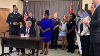 cooper signs budget.jpeg