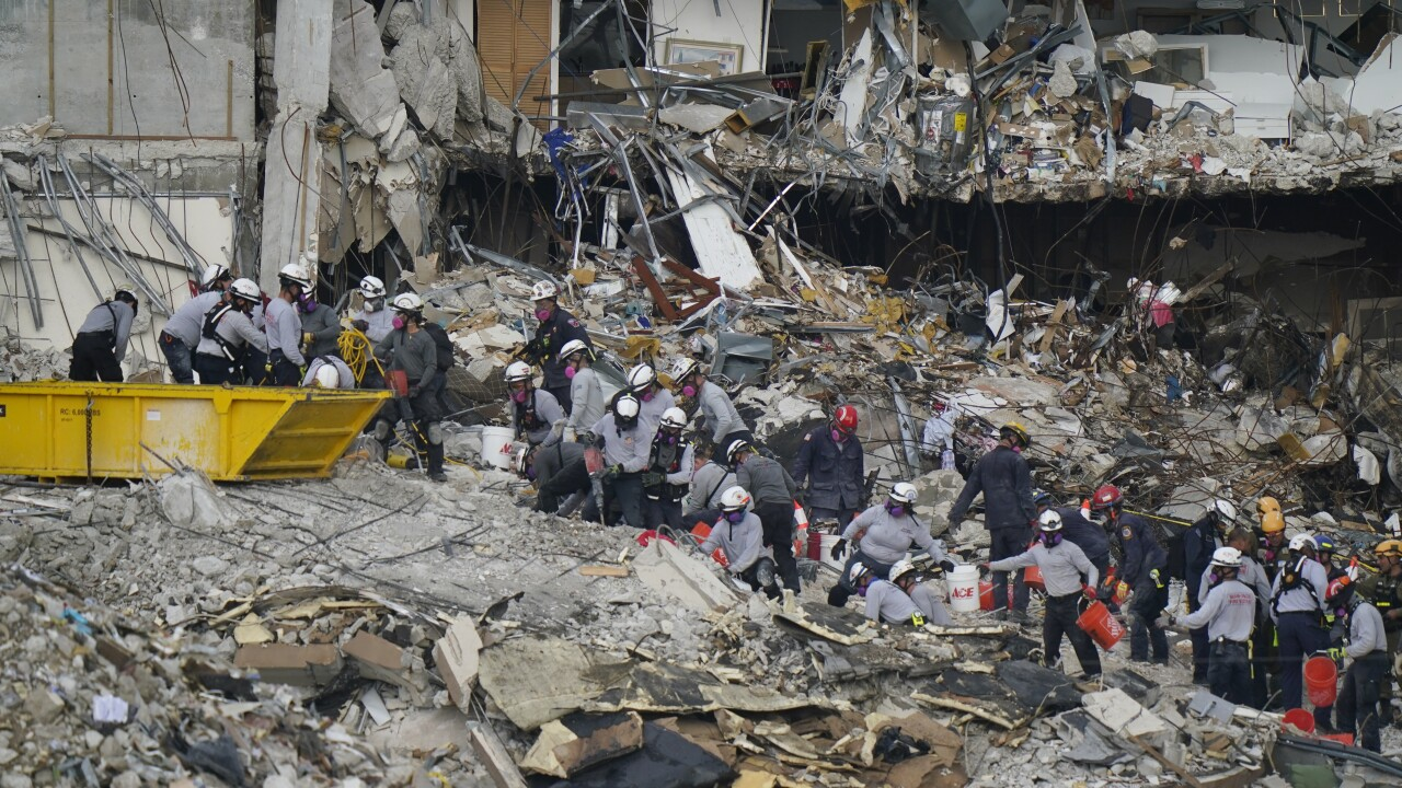 Rescuers work in rubble of Champlain Towers South collapse site, June 29, 2021