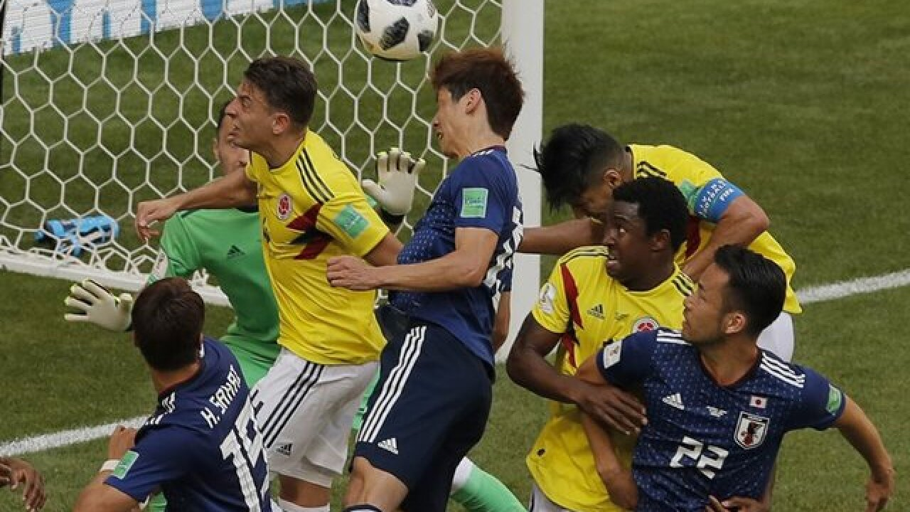 Early penalty helps Japan beat Colombia 2-1 at World Cup