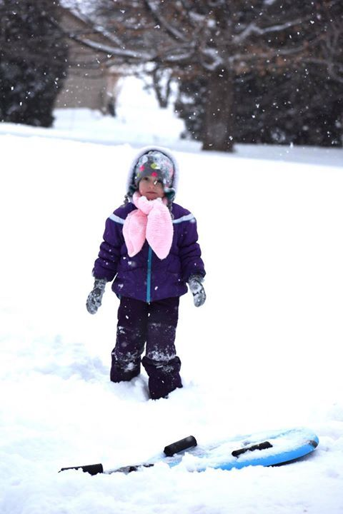Child standing in the snow