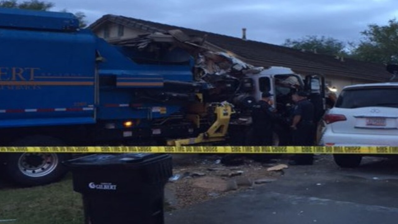 Garbage truck crashes into Arizona house