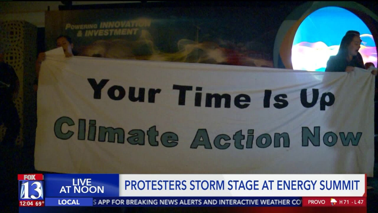 Climate action protesters storm stage at Governors Energy Summit