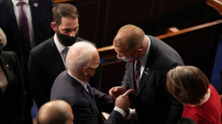 U.S. President Joe Biden briefly spoke with U.S. Rep. Troy Nehls, R-Texas, after delivering an address to a joint session of Congress in the House chamber of the U.S. Capitol in Washington D.C., on April 28, 2021