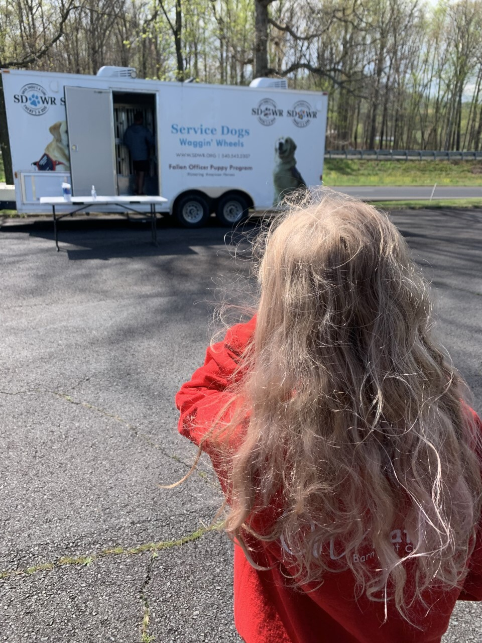 Sophie picking up Jacoby at trailer in winery parking lot in Madison, VA