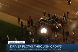 Man detained after driving car through crowd of Breonna Taylor protesters in Denver, police say