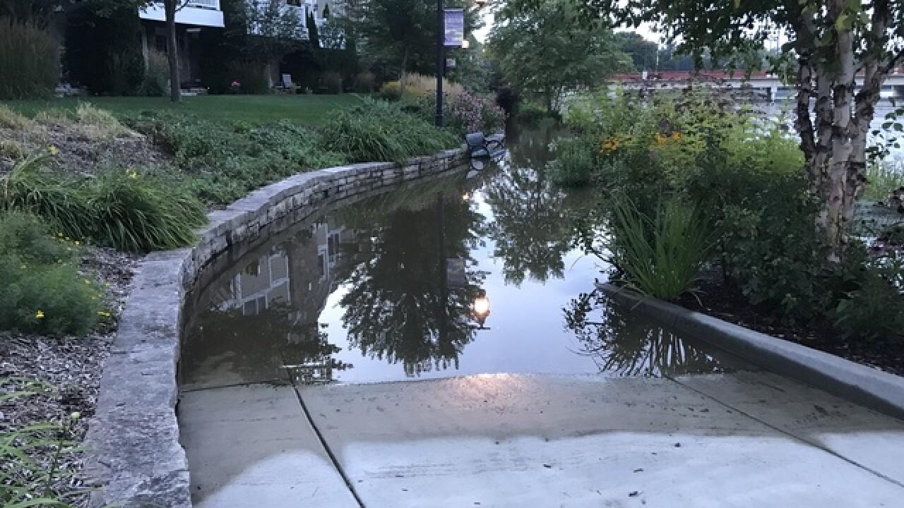 Rising Milwaukee River floods Grafton