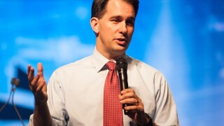 Walker opposes arming teachers, looking at other ideas