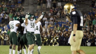 USF Bulls celebrate after 2011 upset at Notre Dame Fighting Irish