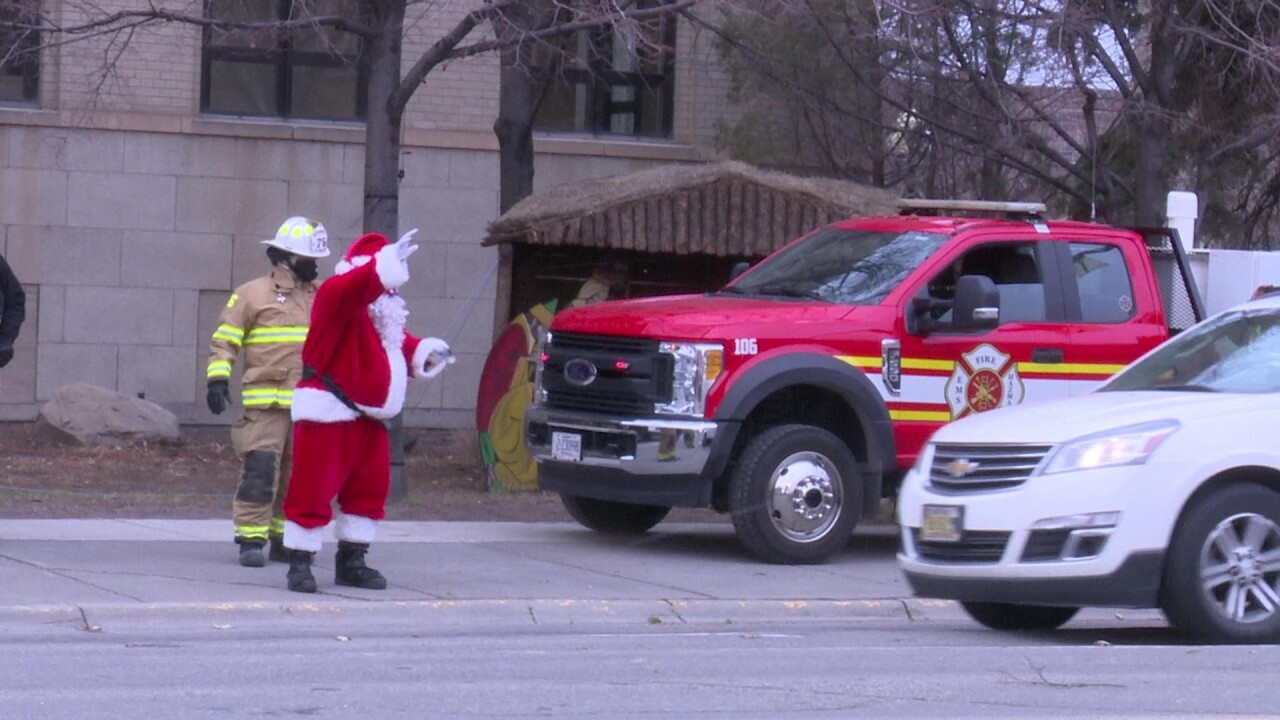 """Great Falls first-responders hosted a """"reverse"""" holiday parade"""