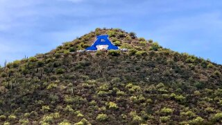 """A"" Mountain painted blue to honor local health care workers"