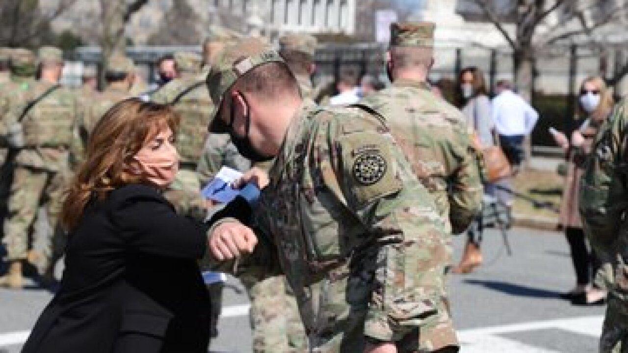 Rep. Lisa McClain with MI Natl Guard via Twitter.jpg