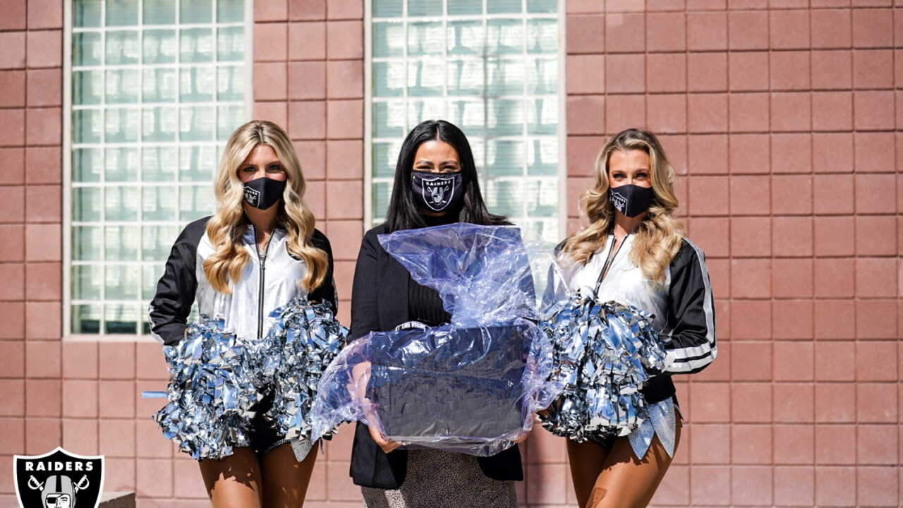Raiderettes Camryn and Nicole flank Ms. Hamrick, Carroll M. Johnston Middle School.jpg
