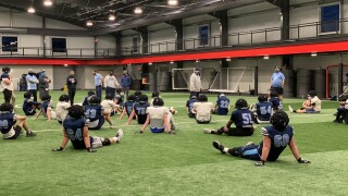 Mona Shores football practice at Whitehall's indoor facility