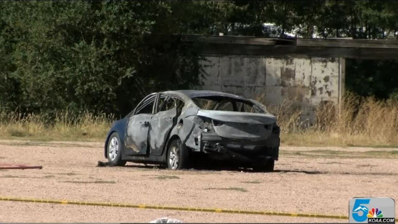 Burned car found with body inside in Pueblo