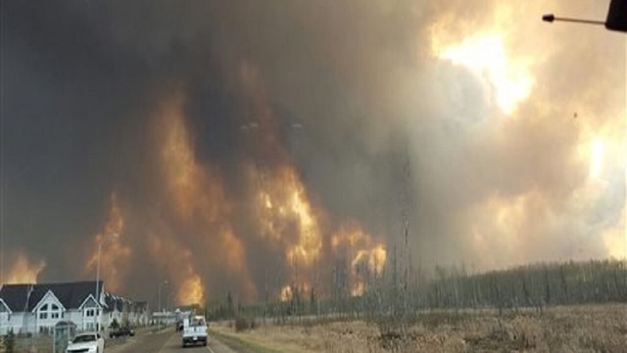 Wildfire forcing people out of homes in Canada
