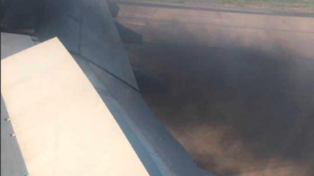 Smoking engine forces Delta plane back to ATL