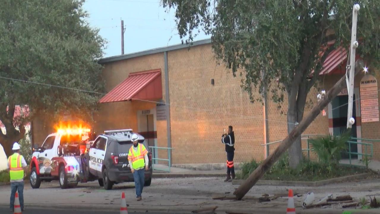 Workmen transport Corpus Christi police vehicle away