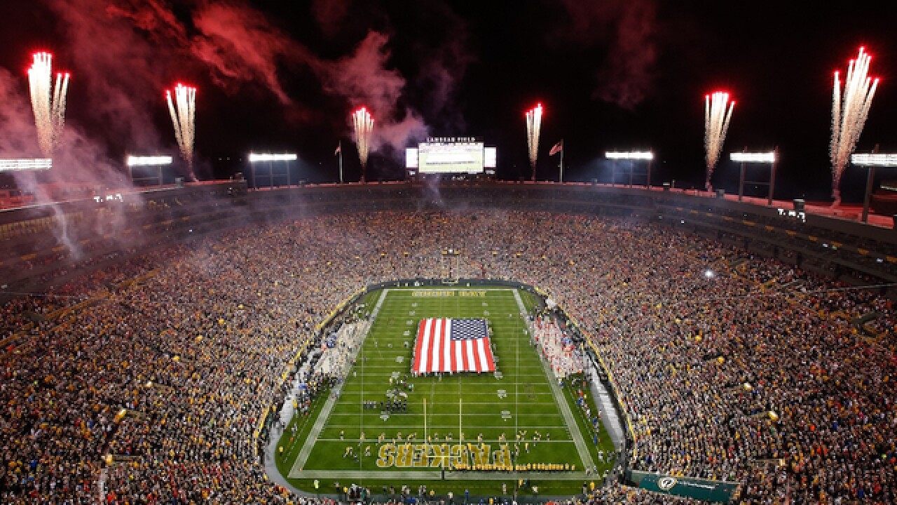 Trampled, discarded flags at Green Bay Packers game leave veterans grumbling