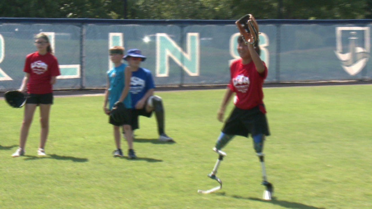 Wounded veterans teach children with missing limbs how to play ball in Virginia Beach