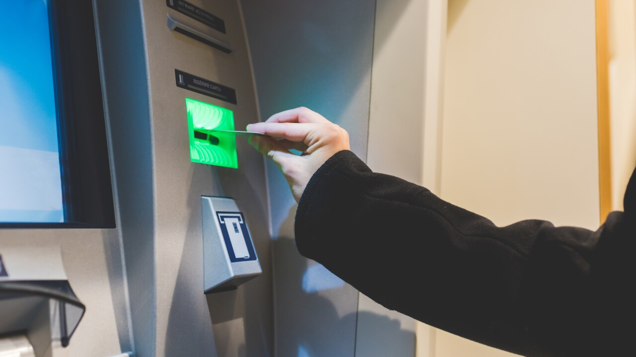 graphicstock-close-up-on-the-hand-of-man-inserting-debit-card-in-atm-machine-money-cas-SBI-304224182.jpg