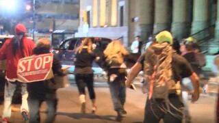 Woman charged after protester is struck by truck in Buffalo
