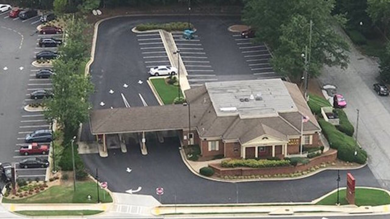 Hostages released from Atlanta bank, suspect killed