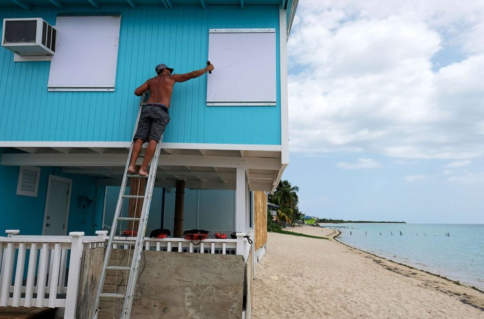 A man boards up a window of a beach house in the tourist zone of El Combate as Tropical Storm Dorian approaches in Cabo Rojo, Puerto Rico, Aug. 27, 2019 (Ricardo Arduengo/Reuters.