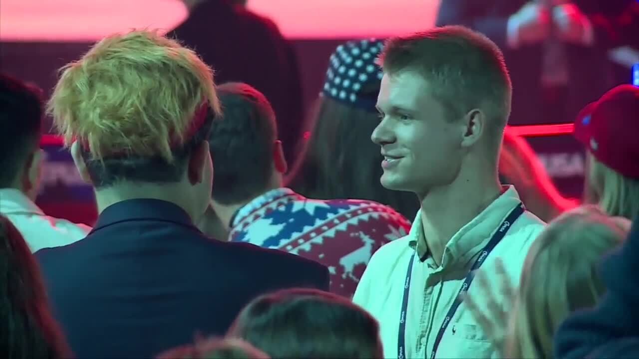 People in close proximity not wearing masks at Turning Point USA conference, Dec. 22, 2020