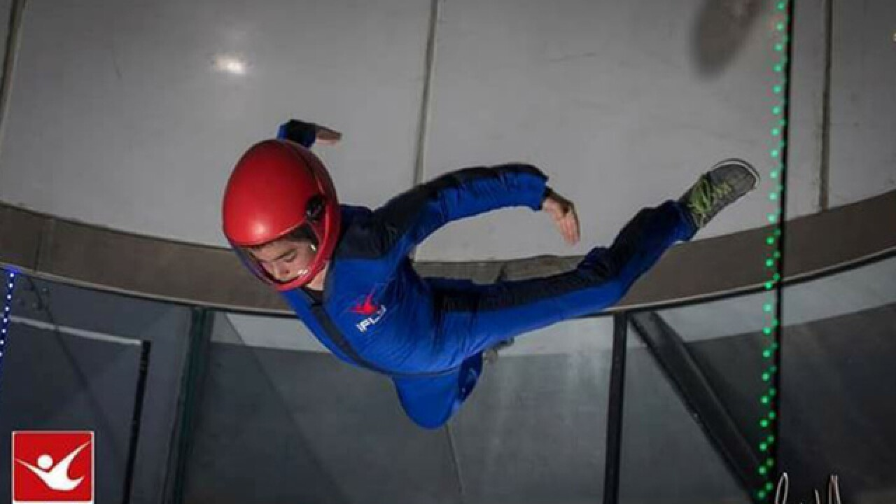 8YO boy uses indoor skydiving as therapy