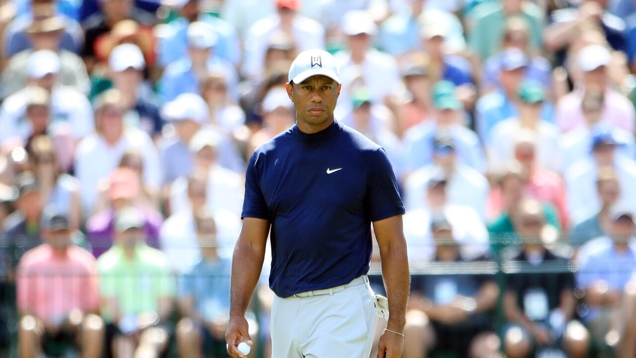 Tiger Woods charge lights up Masters as five major champions share lead