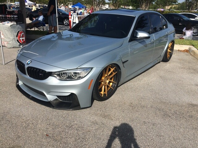 Luxury cars from the Cars & Coffee event at the Palm Beach Outlets