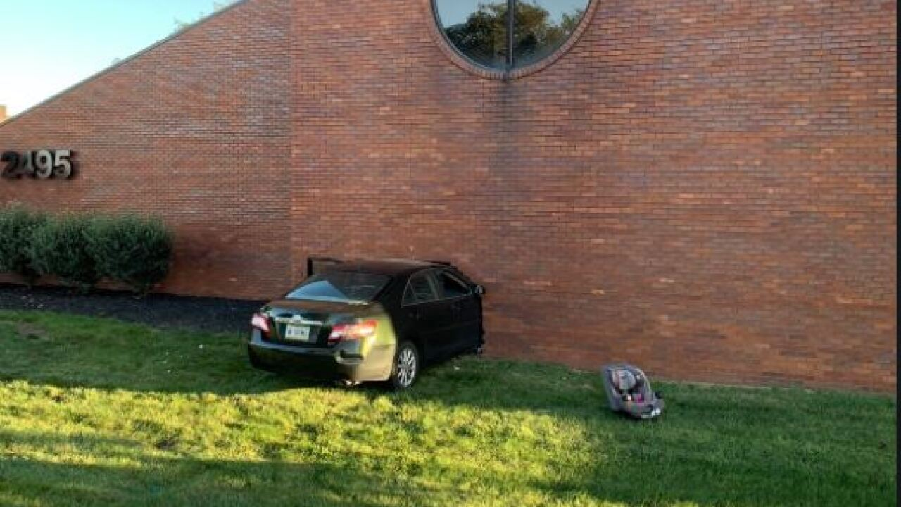 WTFD car into directors row building.JPG