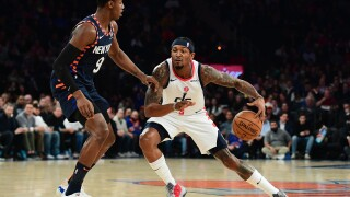 NEW YORK, NEW YORK - DECEMBER 23: Bradley Beal #3 of the Washington Wizards looks to drive past RJ Barrett #9 of the New York Knicks during the first half of their game at Madison Square Garden on December 23, 2019 in New York City.
