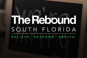'The Rebound South Florida' graphic behind 'we're hiring' sign