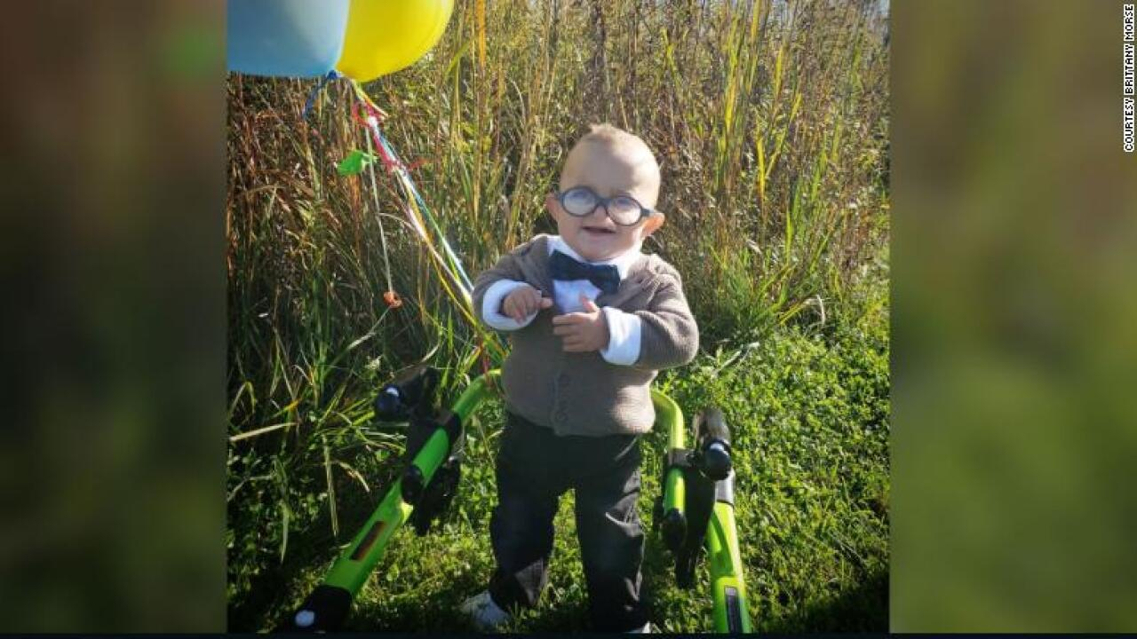 Toddler with cerebral palsy takes Halloween to the next level with 'Up' costume