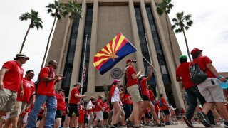 Public schools in Arizona that have weathered a decade of funding cuts with only partial restoration could see a big infusion of cash if a ballot measure backed by teachers and advocacy groups passes in November. Photo/AP.