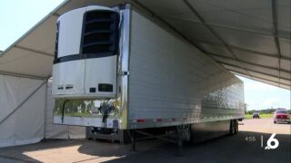Portable morgue trailers in use at local cemetery for COVID deaths